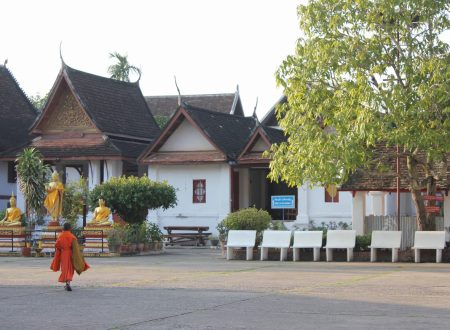 Laos between Wat and Buddhist monks
